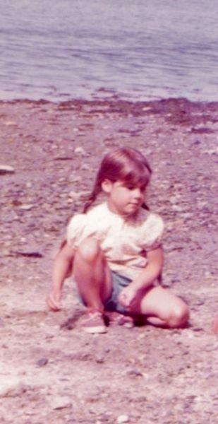 Laura as a kid on beach